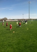 Kids scrimmaging at our Kicking4Hunger Event